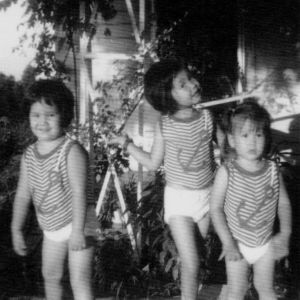 Dancing in the rain at Grandma's house. (I'm the goofy one in the middle.)
